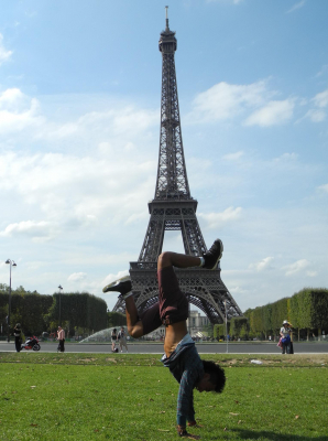 Kevin Velasco doing handstand in front of Eiffel Tower