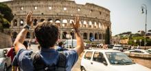man in front of Roman Coliseum