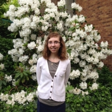 Christina Sztajnkrycer in front of flowering bush