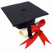 black graduation cap and diploma