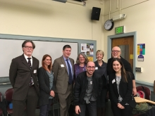 group of eight panelists posing