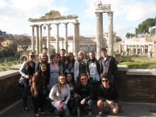 Students at a Roman landmark