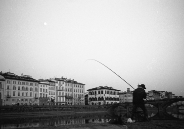 man fishing in florence
