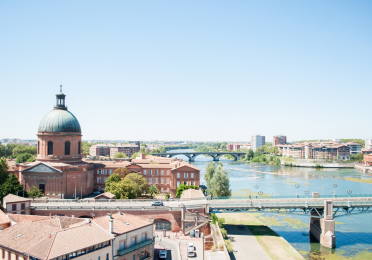 Aerial view of Toulouse, France along the waterfront.