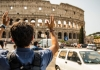 man in front of Roman Coliseum