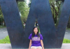 Student in front of purple W