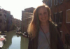 Emma Smith standing over a sunny canal in Venice